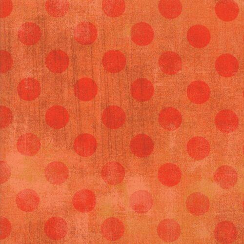 Basic Grey voor Moda Basic. Rode stippen op oranjerode ondergrond.