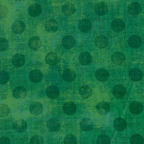 Moderne Groene quiltstof met donkere stippen.